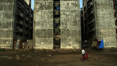 A boy walks with his cycle in Lallubhai Compound, Mumbai, 14 June, 2014.