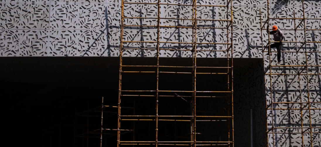 A construction worker works on a building facade, Mumbai, April 24, 2014.
