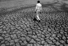 A man walks on the cracks of the reservoir of Manjara Dam, Maharashtra 2016.